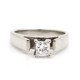 Platinum 0.50 CT Diamond Solitaire Ring: A platinum 0.50 ct diamond solitaire ring. Rising from a recessed gallery is a prong set princess cut diamond.