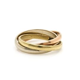 Cartier 18K Tri Gold Ring: A Cartier 18K gold movable ring featuring three interlaced bands of 18K rose gold, 18K white gold and 18K yellow gold.