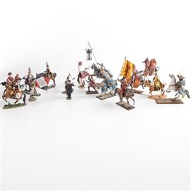 Collection of Military Figurines: A collection of sixteen military figurines. This lot features a variety of figurines, mostly of medieval knights and soldiers, from many European nations and time periods, including medieval mounted knights, a mounted Napoleonic grenadier, foot soldiers wielding axes, swords, and pennants, and more. Also included are figurines representing King George III, Winston Churchill, and an unspecified medieval King of Scotland.