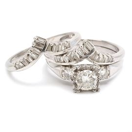 Platinum and 14K White Gold 2.28 CTW Diamond Wedding Ring Set: A platinum and 14K white gold 2.28 ctw diamond wedding ring set. The set includes a platinum engagement ring with round cut diamonds and two 14K white gold chevron shaped wedding bands, set with tapered baguettes.