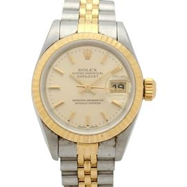 Rolex Two-Tone Oyster Perpetual Datejust Wristwatch: A Rolex two-tone Oyster Perpetual Datejust wristwatch featuring a fluted 18K yellow gold bezel, a calendar sub-dial, and a stainless steel and 18K yellow gold jubilee band.