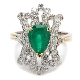 18K White Gold Emerald and Diamond Fashion Ring: An 18K white gold emerald and diamond fashion ring. The ring features a pear shaped emerald center stone in a pierced milgrain setting with forty-three diamond accents.