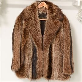"Vintage Raccoon Fur Coat: A vintage raccoon fur coat by Gidding Jenny. The charming fur coat is a two-tone brown and features a wide collar. It is monogrammed ""Debbie Katz"" on the interior."