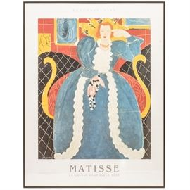 "Henri Matisse Retrospective Framed Print ""La Grande Robe Bleue 1937"": A framed Retrospective print after french artist, Henri Matisse, titled La Grande Robe Bleue 1937. Depicted is a portrait of a woman in a blue dress. It is presented behind glass and framed in a metal frame. Wired and ready to hang."