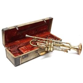 "Getzen Super Deluxe Trumpet and Case: A brass Getzen Super Deluxe B-flat trumpet, serial number 40745. Features include a lacquer finish on its tri-color brass, rose brass and silver tone bell section, valve casings and slides. The rose brass band around the bell is marked ""Getzen; Elkhorn, Wis.; Tone Balanced; Super Deluxe."" A Getzen trumpet mouthpiece is also included with a red velvet lined Getzen case."