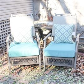 Four La-Z-Boy Metal Frame Patio Chairs: A set of four patio chairs by La-Z-Boy. Each of these chairs features a hollow cast metal frames with brown powder coated finish and removable teal all-weather cushions. This item matches 17COL214-085.