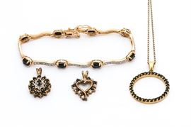 Gold Wash on Sterling Silver Sapphire and Diamond Jewelry: A set of gold wash on sterling silver jewelry including a bracelet with oval cut sapphires and diamond accented links, a scalloped sapphire and diamond pendant, a heart shaped sapphire and diamond pendant, and a chain necklace with round sapphire pendant.