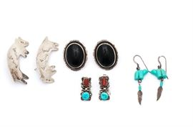 Sterling Silver Southwestern Style Earrings: A set of sterling silver Southwestern style earrings including a pair of engraved bear shaped earrings, a pair of oval cabochon black onyx earrings, a pair of turquoise and coral earrings, and a pair of dangle earrings with bear carved beads.