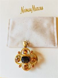 19K yellow gold and colored stone pendant featuring a center faceted cushion shaped smoky quartz surrounded by four squared shaped golden citrines and eight round cut mandarin garnets designed by Elizabeth Locke