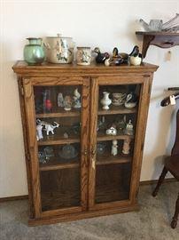 Side oak curio cabinet