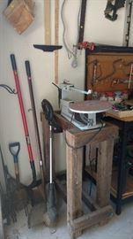 Woodworking  saw,  shovel, weed eater, rake, workbench,