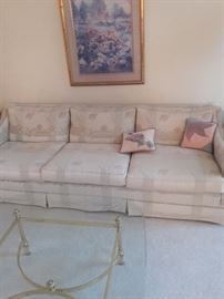 Nice Couch with tan, light blue and light pink accents