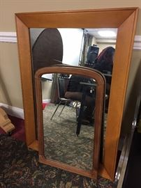 1 vintage and 1 Mid-Century Modern hanging mirrors.