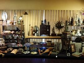 A LONG DISPLAY OF COLLECTIBLES