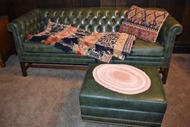 Leather sofa and ottoman; vintage and in good condition.  Vintage pillow and linen