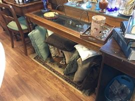 Glass Top Foyer Table. Decorative pillows.