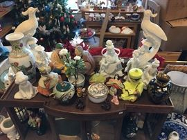 Asian Figurines and Art pieces displayed on an antique shelf of some sort.