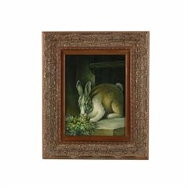 Oil Painting on Canvas of a Rabbit: An oil painting on canvas of a rabbit. This unsigned piece depicts a fluffy tailed rabbit nibbling on some foliage. The painting is presented in a gold tone gesso and wood frame with an elaborate running band. A wire is present to the verso for hanging purposes.