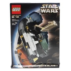 "Lego ""Star Wars"" 7153 ""Jango Fett's Slave I"": A factory sealed Lego Star Wars kit 7153, ""Jango Fett's Slave I""."