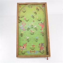 """Vintage Bagatelle Poosh-M-Up """"Big 5"""" Ball Bearing Game: A vintage Bagatelle Poosh-M-Up """"Big 5"""" ball bearing game. This early pinball style game features a board with a green background decorated with numerous humorous illustrations of figures playing sports. The board, set in a natural wood frame, is designed for five games: Put-N-Take, Base-Ball, Twenty-One, Pennants and Bagatelle. The upper left corner the game is marked """"Made in U.S.A Northwestern Products St. Louis, MO. Pat No 1925018""""."""
