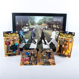 Beatles Yellow Submarine Figures and Framed Abbey Road Three-Dimensional Poster: An assortment of Beatles memorabilia including four Yellow Submarine figures and one framed three-dimensional poster of The Beatles Abbey Road. There are four, one for each member, the Yellow Submarine action figures. Each comes with a character from The Yellow Submarine and are marked accordingly in their boxes. The framed three-dimensional poster is housed in a black wooden frame with wire to the verso for hanging. It shows The Beatles infamous Abbey Road with the four members walking across the cross-walk.