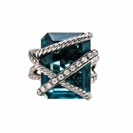 """David Yurman Sterling Silver """"Cable Wrap"""" London Blue Topaz and Diamond Ring: A David Yurman sterling silver 23.00 ct London blue topaz and diamond ring in the Cable Wrap line. This ring showcases a London blue topaz center, accented by thirty diamonds adorned throughout the overlapping twisted rope openwork design. The total carat weight of all diamonds included is 0.33 ctw."""