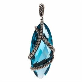 """David Yurman Sterling Silver """"Cable Wrap"""" London Blue Topaz and Diamond Pendant: A David Yurman sterling silver London blue topaz pendant in the Cable Wrap line. This pendant showcases a marquise checkerboard faceted London blue topaz, accented by fifteen diamonds adorned throughout the overlapping twisted rope designs. The total carat weight of all diamonds included is 0.23 ctw."""