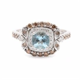 LeVian 14K White Gold Aquamarine and Diamond Ring: A LeVian 14K white gold aquamarine and 0.61 ctw diamond ring. This ring features a center cushion checkerboard aquamarine stone within a square halo of diamonds with foliate accents set between diamond set shoulders.