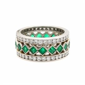 Platinum Emerald and 1.55 CTW Diamond Band: A platinum emerald and 1.55 ctw diamond band. This band showcases nineteen emeralds to the openwork navette designed center, accented by seventy-two diamonds adorned to the sides.