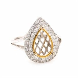 14K White Gold Diamond Semi Ring Mount: A 14K white gold diamond semi ring mount. This semi ring mount features a pear-shaped crown with an empty prong setting trimmed with yellow gold. Bordering this empty setting are two rows of diamonds held between split shoulders.