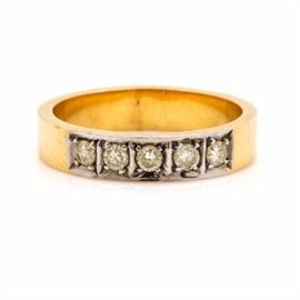 14K Yellow and White Gold Diamond Band: A 14K yellow and white gold diamond band. This ring features a row of diamonds set in a white gold setting with a yellow gold band.