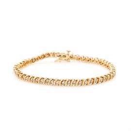 14K Yellow Gold and Diamond Tennis Bracelet: A 14K yellow gold and diamond tennis bracelet.