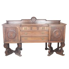 Antique Jacobean Hardwood Buffet: An antique hardwood buffet. This Jacobean piece features a carved medallion theme with rectangular top above three shallow drawers, flanked by two cabinets upon elaborately carved feet. This item coordinates with items 17COL224-036; 17COL224-040; 17COL224-043 in this sale.