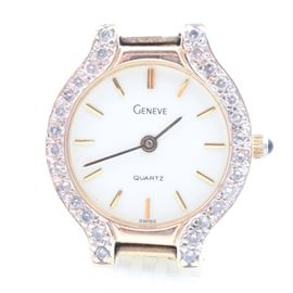 Geneve 14K Yellow Gold Diamond Wristwatch: A Geneve 14K yellow gold wristwatch with twenty-eight diamonds adorning the bezel.