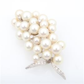 14K White Gold Pearl and Diamond Brooch: A 14K white gold, pearl and diamond brooch.