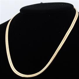 14K Yellow Gold Herringbone Necklace: A 14K yellow gold herringbone necklace.