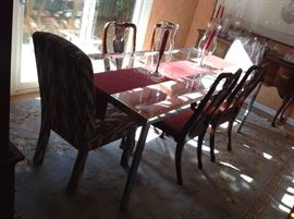 Glass / Chrome banquet table with 6 chairs $ 400.00