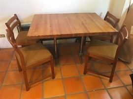 Solid butcher block table with chrome legs! Danish modern chairs (6 total - only 4 shown)