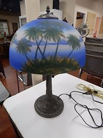 Reverse painted palm tree glass shade lamp