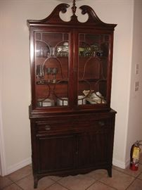 Mahogany china cabinet with swan-neck