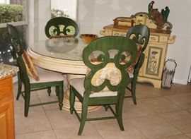 Nice painted round table and chairs.