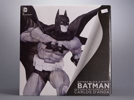 Offered is a black and white Batman figure from DC Collectibles, new in box. The figure is sealed in the styrofoam inside the box. There is a price sticker on the front. Please see the photos at completeset.com for details.