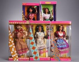 Offered is a lot of 5 Barbie dolls from the 1990s, new in box: Native American Barbie, Italian Barbie, Australian Barbie, Mexican Barbie, and Chinese Barbie. The corners of the boxes are damaged and the bubbles are dented. Chinese Barbie has a price sticker, and Mexican Barbie has sticker residue. Please see the photos at completeset.com for details.