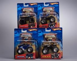 Offered is a lot of 4 Hot Wheels Monster Jam trucks. The cards show normal shelf wear but the toys are undamaged. Please see the photos at completeset.com for details.