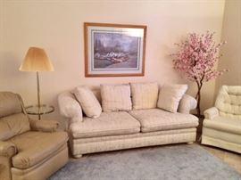 Tan Barcalounger, sofa and pink apple blossom tree