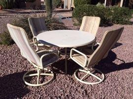 Samsonite Fiberglass Round Table w/ 4 Swivel Rocking Chairs