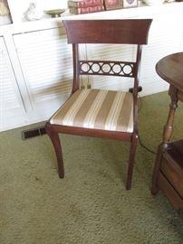 Mahogany side  chair w/sabre leg $75.00