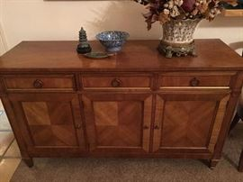 Kindel fruitwood buffet with four piece mached venner Top 56 x 19. Height 33. Center drawer divided with tarnish resistant cloth. Behind the two right hand doors there is a large drawer for linen and a removable shelf.