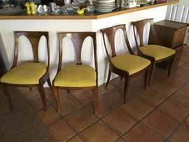 Set of four Kindel side chairs in the Hollywood Regency style with original yellow upholstery . W. 19 D. 18. H 33.