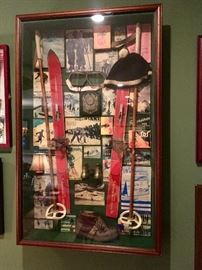 Framed shadowbox collage of vintage ski themed collectibles